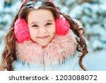 winter portrait of happy kid... | Shutterstock . vector #1203088072