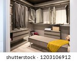 interior of a walk in closet... | Shutterstock . vector #1203106912