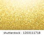 glittering defocused gold... | Shutterstock . vector #1203111718