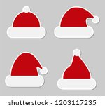 sticker red christmas hats.... | Shutterstock .eps vector #1203117235