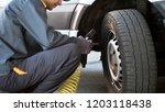 mechanic checking the pressure... | Shutterstock . vector #1203118438