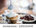 preparing delicious cappuccino  ... | Shutterstock . vector #1203132445
