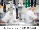 unfocused restaurant's kitchen... | Shutterstock . vector #1203132478