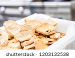 tasty rusks in a big amount in... | Shutterstock . vector #1203132538