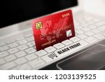 red credit card with black... | Shutterstock . vector #1203139525