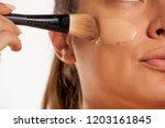young woman applying liquid... | Shutterstock . vector #1203161845