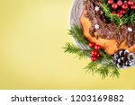 christmas cake on yellow... | Shutterstock . vector #1203169882