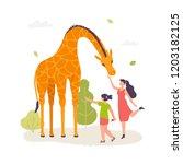 girls in the zoo interacting... | Shutterstock .eps vector #1203182125