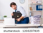 overloaded busy employee with...   Shutterstock . vector #1203207835