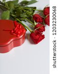 a bouquet of scarlet roses and... | Shutterstock . vector #1203230068