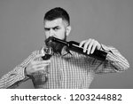 winemaker with strict face...   Shutterstock . vector #1203244882