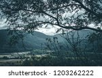 wide mountain range looking... | Shutterstock . vector #1203262222