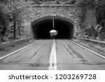 isolated tunnel in mountain.... | Shutterstock . vector #1203269728
