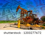 the oil pump  the dollar and... | Shutterstock . vector #1203277672