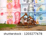 the oil pump  the dollar and... | Shutterstock . vector #1203277678