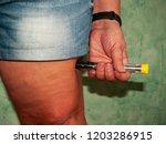 an allergic woman injecting an... | Shutterstock . vector #1203286915