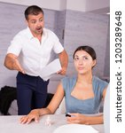 irritated husband with papers... | Shutterstock . vector #1203289648