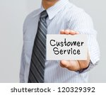 hand holding customer service card - stock photo