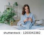 indoor shot of happy dark... | Shutterstock . vector #1203342382