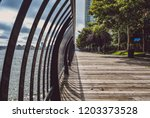 outdoor riverfront walkway.... | Shutterstock . vector #1203373528