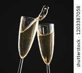 glasses of champagne with splash | Shutterstock . vector #1203387058