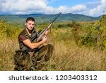 hunting hobby and leisure. man... | Shutterstock . vector #1203403312