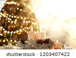 christmas night candles... | Shutterstock . vector #1203407422