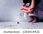 Murderer Bloody Hand Holding...