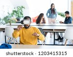 serious concentrated young...   Shutterstock . vector #1203415315