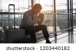 businessman stressed from... | Shutterstock . vector #1203440182