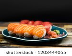 fresh sushi traditional... | Shutterstock . vector #1203444055