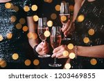 friends celebrating christmas... | Shutterstock . vector #1203469855