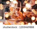 friends celebrating christmas... | Shutterstock . vector #1203469888