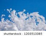 white soap foam on a blue sky...   Shutterstock . vector #1203513385