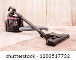 vacuum cleaner in the room on... | Shutterstock . vector #1203517732