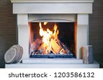 a warm fire in the stone... | Shutterstock . vector #1203586132