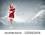 Portrait of beautiful young woman wearing santa claus clothes - stock photo
