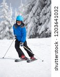 young boy skiing on slope in...   Shutterstock . vector #1203641032