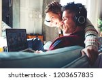 happy couple in love at home.... | Shutterstock . vector #1203657835