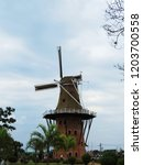 the windmill of holambra ... | Shutterstock . vector #1203700558