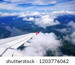 airplane wing in blue sky lots... | Shutterstock . vector #1203776062