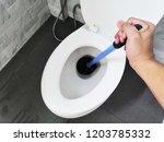 toilet repair by hand plumbing... | Shutterstock . vector #1203785332