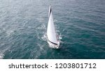 sailing yacht at high speed at... | Shutterstock . vector #1203801712