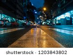 city streets in the rain at... | Shutterstock . vector #1203843802