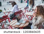 two woman in cafe sitting at... | Shutterstock . vector #1203860635
