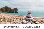 Pebble Stack On The Beach With...