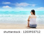 asian woman relaxing on the... | Shutterstock . vector #1203933712