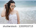 asian woman relaxing on the... | Shutterstock . vector #1203933715