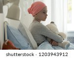 sick child with cancer sitting... | Shutterstock . vector #1203943912