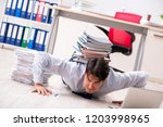 extremely busy employee working ...   Shutterstock . vector #1203998965